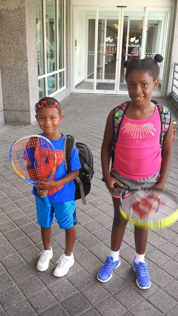 Two oldest kids with tennis racquets