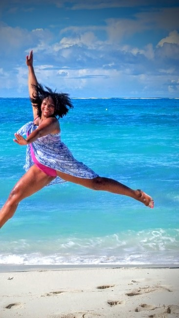 Maria leaps for joy at the 2015 Social Media on the Sand conference.