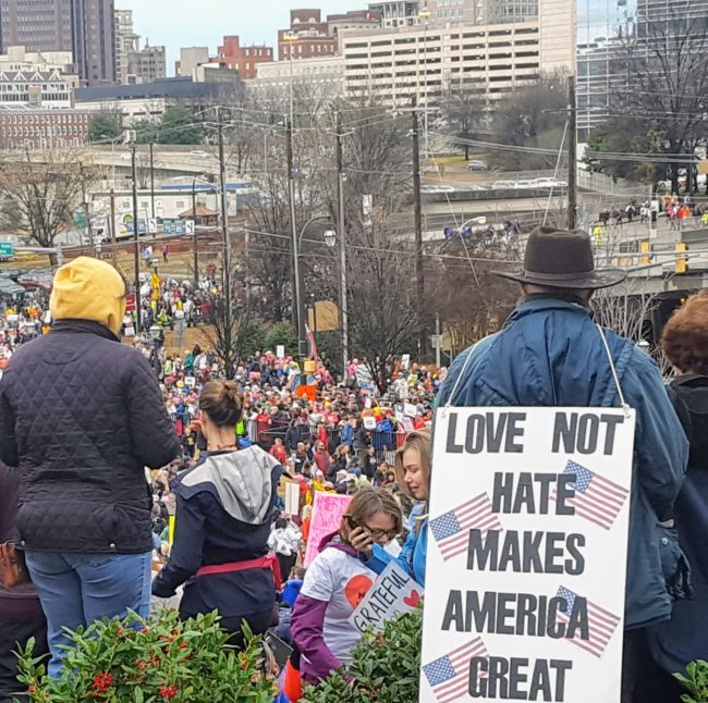 """""""Love not hate makes America great."""" This is a great sign from the Women's March in Atlanta that was not a color blind affair."""
