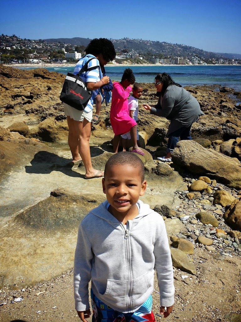 Smith family and Tide Water docent at Inn at Laguna Beach