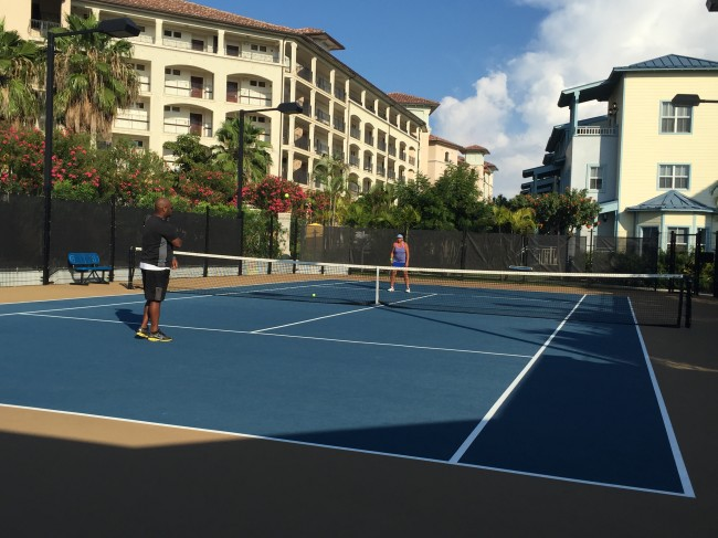 Maria and husband playing tennis