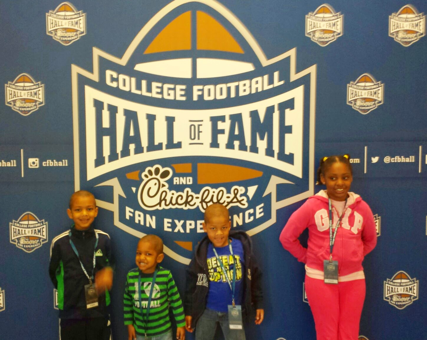 College Football Hall of Fame kids by the logo