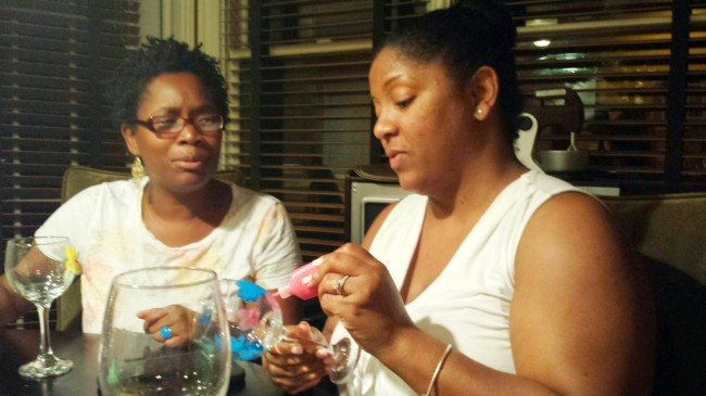 Atlanta Mocha Moms doing a craft at the Moms Nite Out party