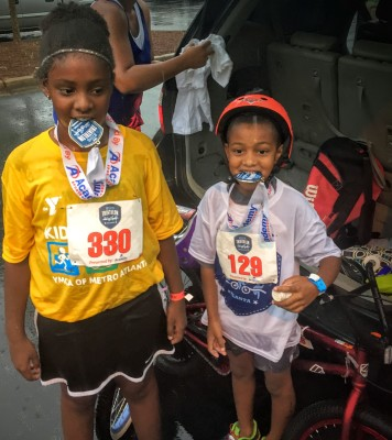 By learning how to ride a bike, my kids had the confidence to complete a kids triathalon!