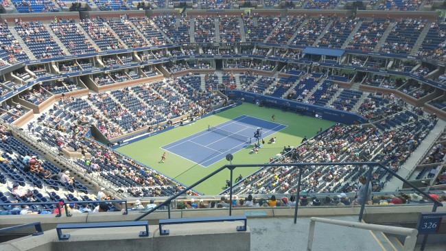 Arthur Ashe Stadium is a gigantic stadium! The new roof helps to shield players and spectators from the harsh sun.