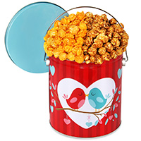 His and hers popcorn tin from Via gourmetgiftbaskets.com.
