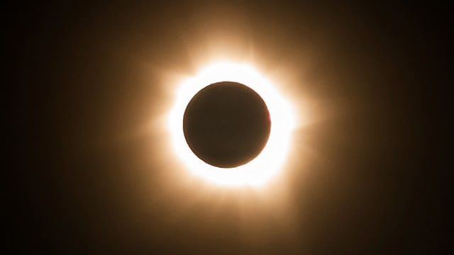 You can watch a solar eclipse safely by using eclipse glasses or watching online.